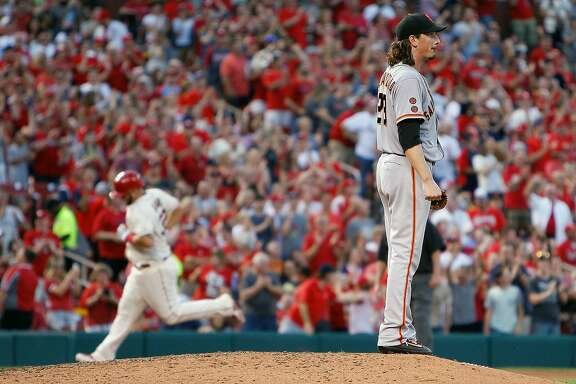 San Francisco Giants starting pitcher Jeff Samardzija, right, pauses on the mound as St. Louis Cardinals' Matt Adams runs the bases after hitting a solo home run during the sixth inning of a baseball game Saturday, June 4, 2016, in St. Louis. (AP Photo/Scott Kane)