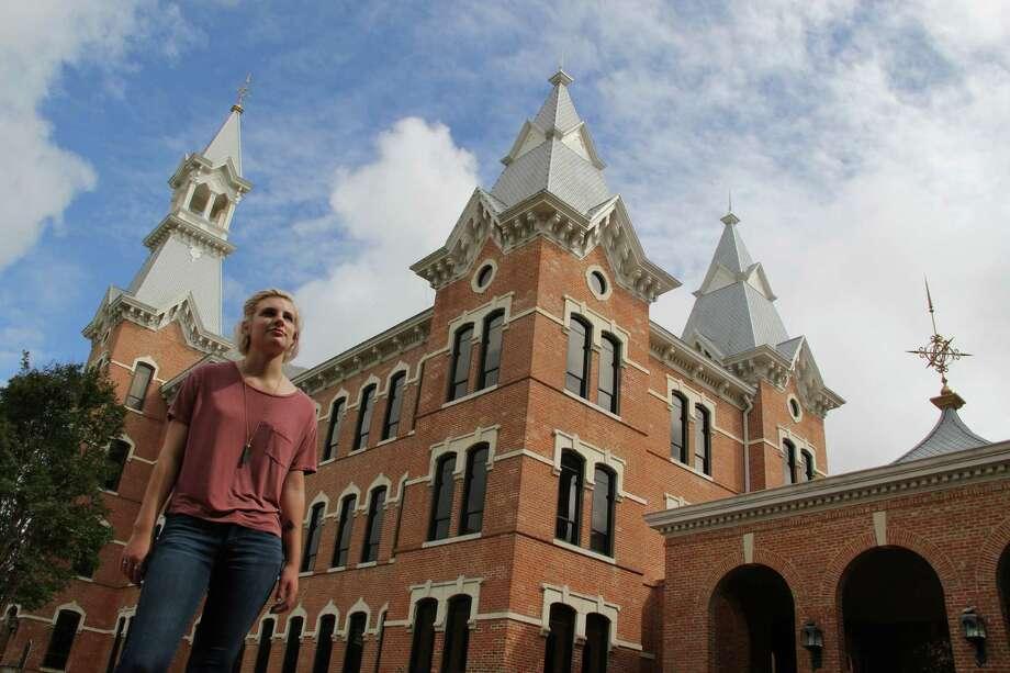 Anya Maltsberger stands outside of Burleson Hall, originally a dorm for female students. Photo: Andrea Zelinski / Houston Chronicle
