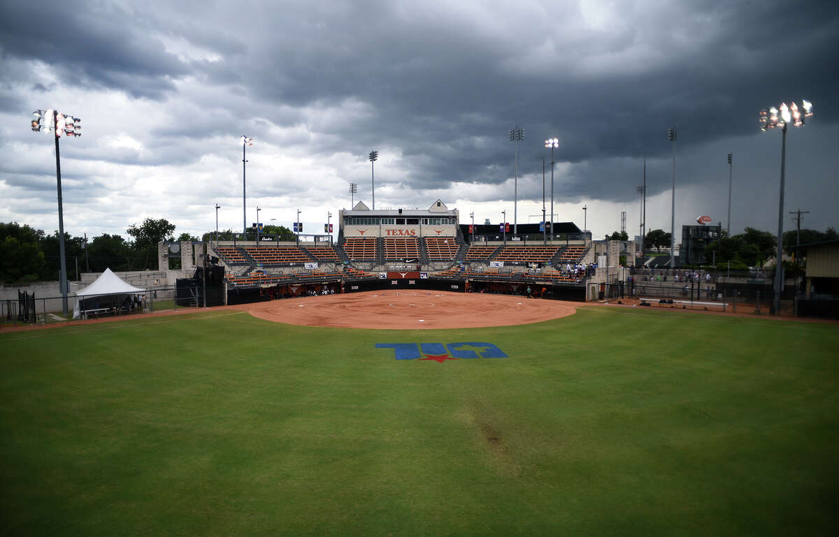 Dark clouds move in over McCombs Field after a lightning strike caused an interruption of play in the top of the first inning of the Class 6A finals matchup between the Pearland Lady Oilers and the Keller Lady Indians at the 2016 UIL Softball State Championships at McCombs Field in Austin on Saturday, June 4, 2016. (Photo by Jerry Baker/Freelance)