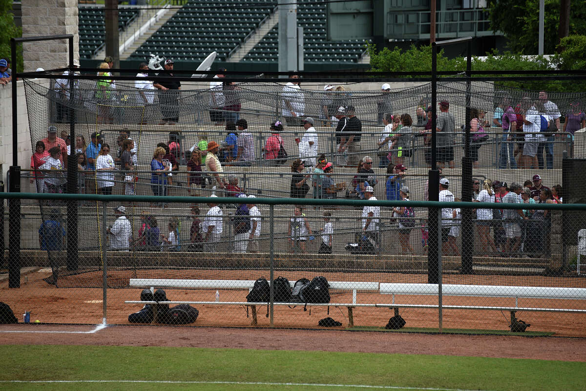 Fans were forced to exit the stands at McCombs Field after a lightning strike caused an interruption of play in the top of the first inning of the Class 6A finals matchup between the Pearland Lady Oilers and the Keller Lady Indians at the 2016 UIL Softball State Championships at McCombs Field in Austin on Saturday, June 4, 2016. (Photo by Jerry Baker/Freelance)