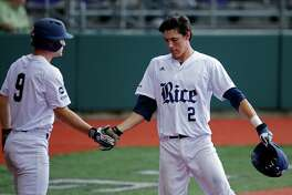 Rice's Tristan Gray (2) is greeted by Dayne Wunderlich (9) after scoring on a double in the fifth inning of an NCAA college regional baseball game against Southeastern Louisiana in Baton Rouge, La., Saturday, June 4, 2016. (AP Photo/Gerald Herbert)
