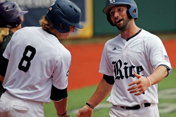 Rice's Hunter Kopycinski (4) is greeted by Ford Proctor (8) after he scored on a fielding error by Southeastern Louisiana in the fifth inning of an NCAA college regional baseball game in Baton Rouge, La., Saturday, June 4, 2016. (AP Photo/Gerald Herbert)