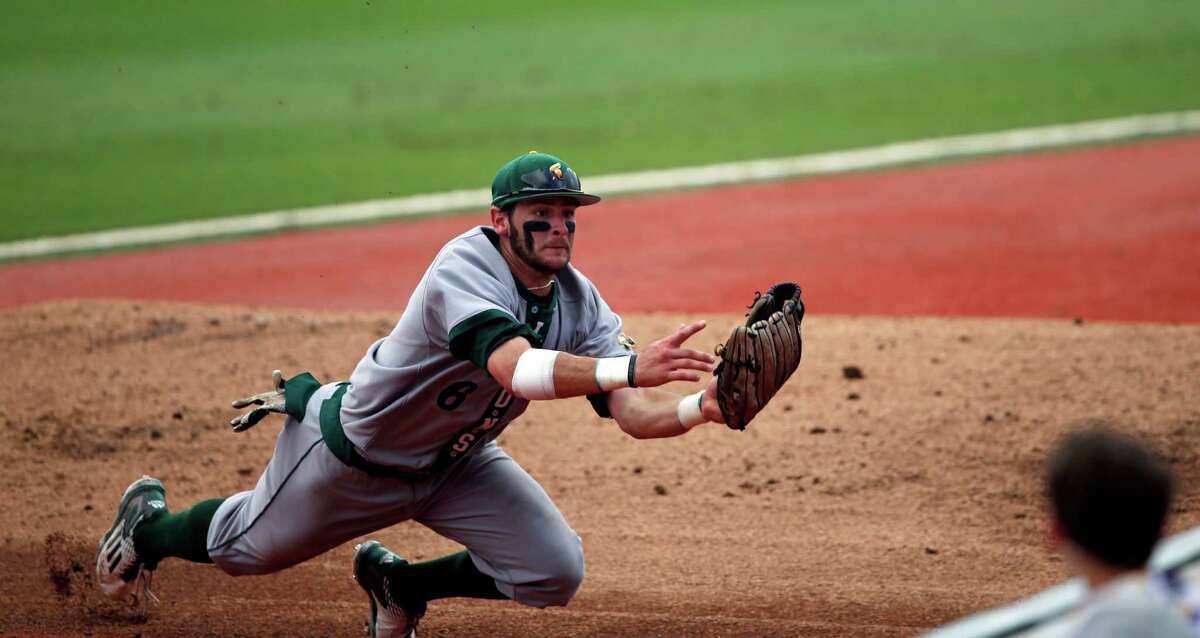 Southeastern Louisiana's Ryan Byers (6) grabs a pop foul off the bat of Rice's Grayson Lewis in the fourth inning of an NCAA college regional baseball game in Baton Rouge, La., Saturday, June 4, 2016. (AP Photo/Gerald Herbert)