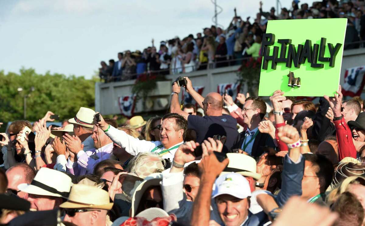 The American Pharoah supporters are in the crowd on Belmont Stakes Day on June 6, 2015, at Belmont Park in Elmont. No fans will be allowed Saturday. (Skip Dickstein/Times Union)