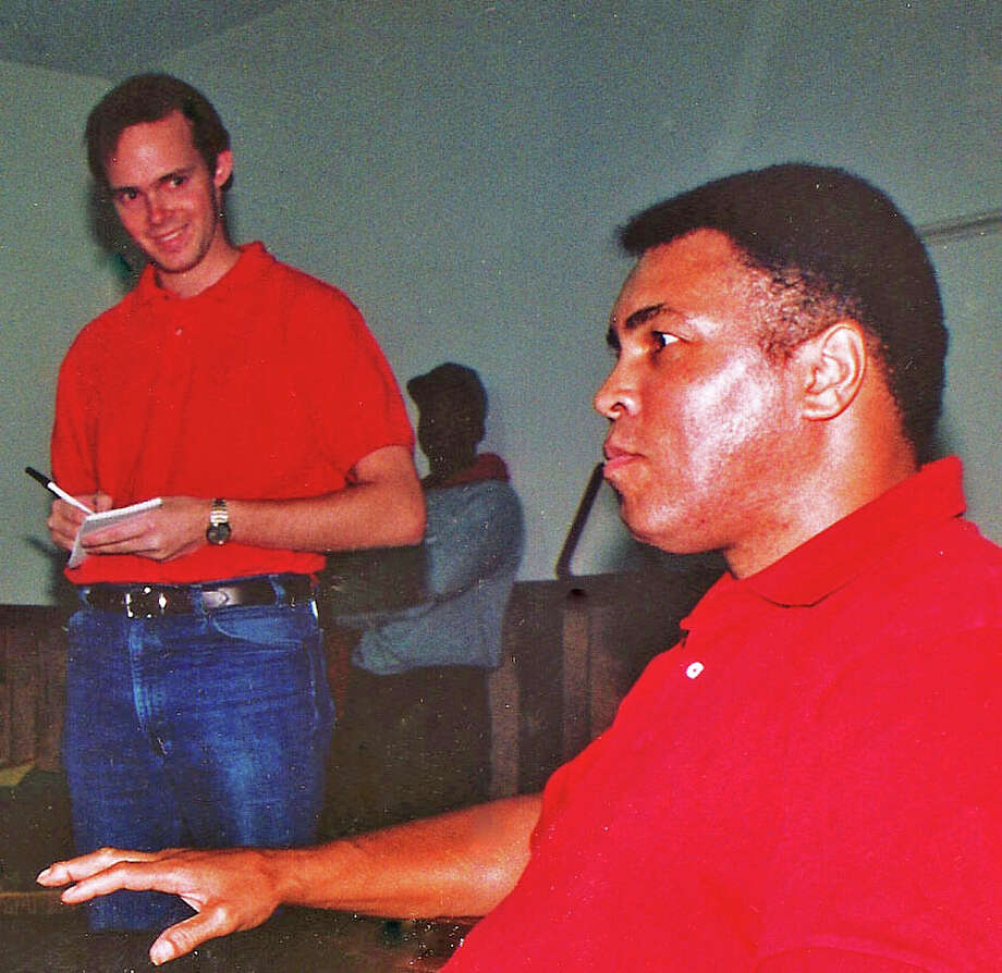 Muhammad Ali speaks with Special Olympians at the Greenwich Police Department in October 1993, as reporter John Breunig takes notes. Photo: File Photo / Stamford Advocate  contributed