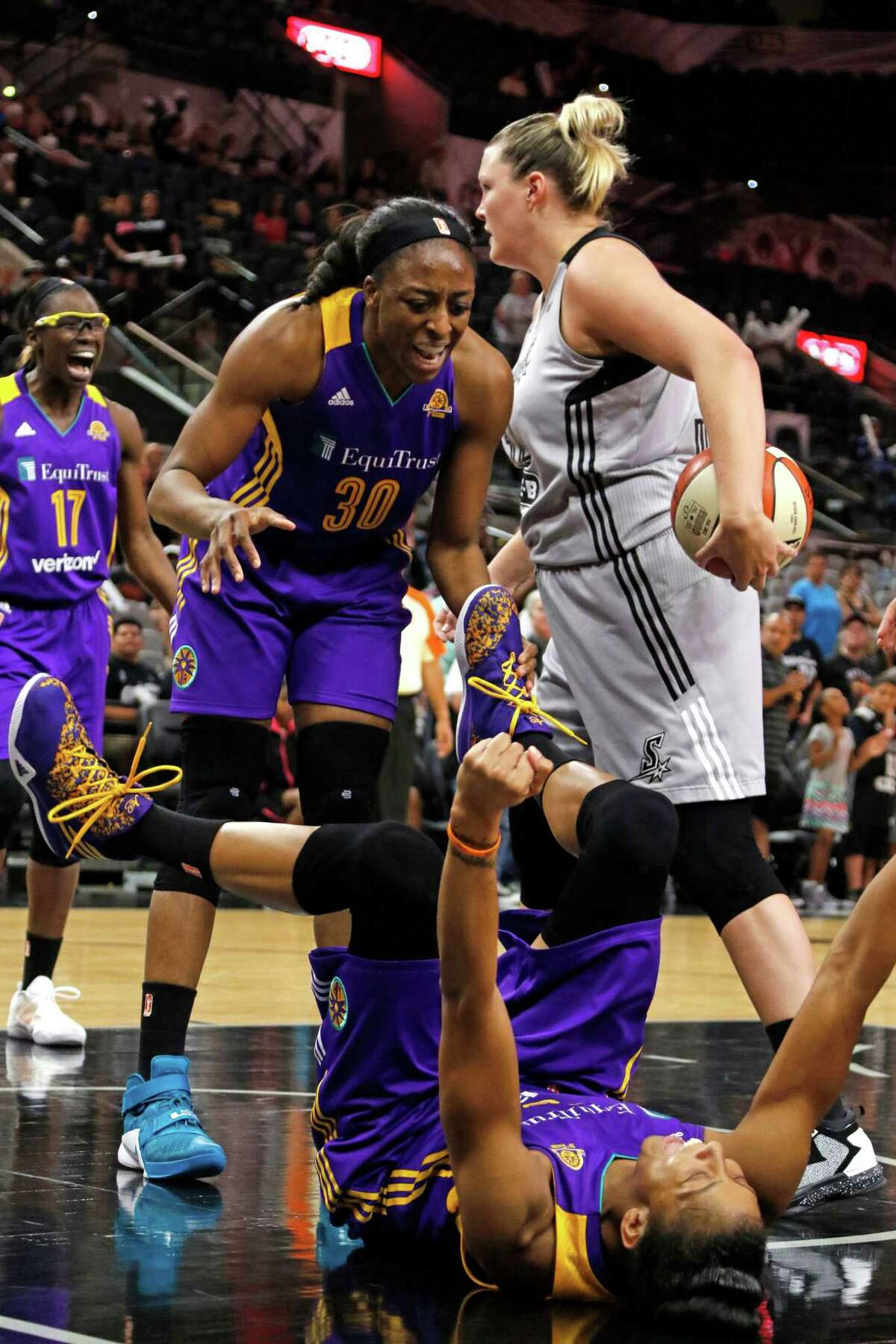 Los Angeles Sparks Candace Parker celebrates with Los Angeles Sparks Nneka Ogwumike after she drew the charge from San Antonio Stars?• Jayne Appel-Marinelli Saturday, June 4, 2016 at AT&T Center.