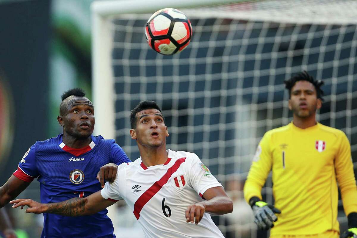 Haiti's Wilde-Donald Guerrier (left) and Peru's Miguel Trauco (right) vie for a header in front of Peru's goal during the second half of the Copa America Centenario game between Haiti and Peru, Saturday, May 4, 2016 at CenturyLink Field. Peru won 1-0.