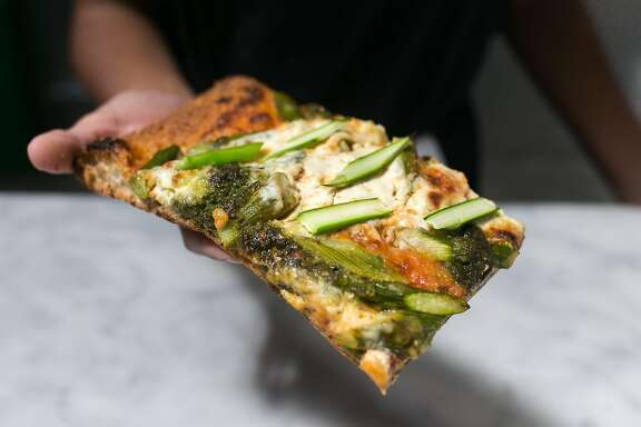 Pizza with pesto, asparagus and ricotta at The Den in S.F.