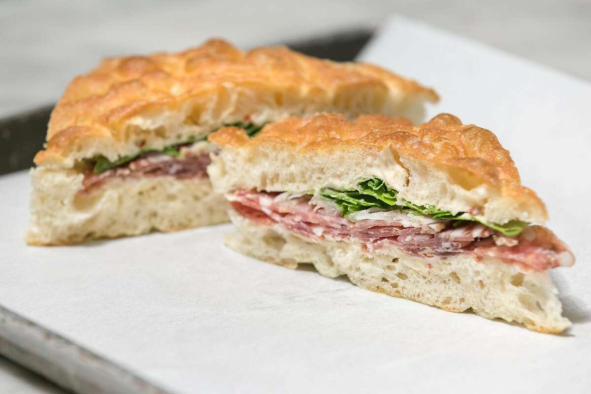 Salami sandwich on garlic focaccia at The Den in S.F.