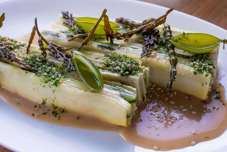 Summer squash, sliced lengthwise, is a masterful blend of cultures with the vegetables interspersed with tofu skin. Photo: John Storey, Special To The Chronicle