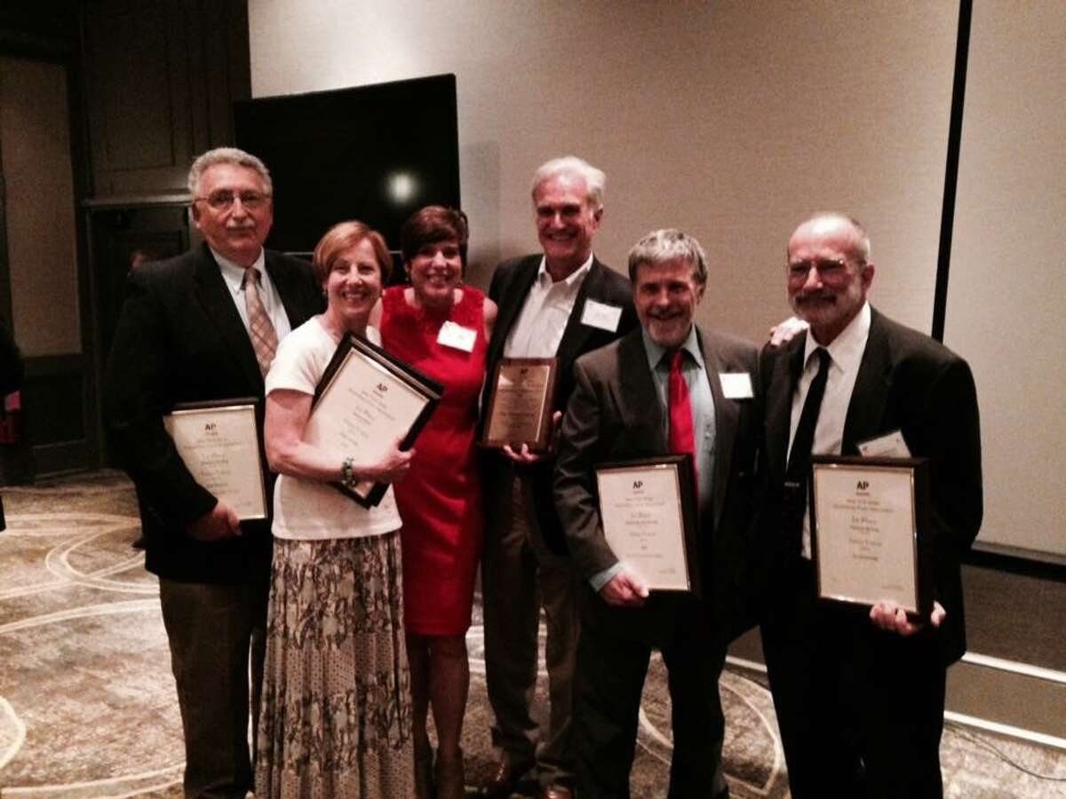 Staff members at the Times Union were honored at the New York State Associated Press Association awards Saturday, June 4, 2016 in Saratoga Springs. Times Union staff members pictured starting at left: John Runfola, Cindy Schultz, Tracy Ormsbee, Rex Smith, Gary Hahn and Jay Jochnowitz. (Provided)