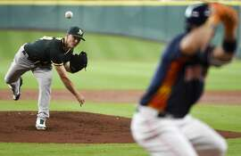 Oakland Athletics starting pitcher Sonny Gray, left, delivers to Houston Astros' Jose Altuve during the first inning of a baseball game, Sunday, June 5, 2016, in Houston. (AP Photo/Eric Christian Smith)