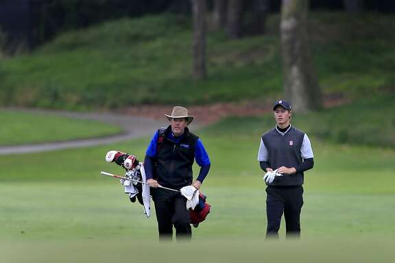 Maverick McNealy (right) and his father Scott approached the 12th green at the Olympic Club Monday June 2, 2014. Qualifying rounds for the U.S. Open were held at The Olympic Club and Lake Merced.
