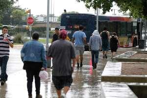 VIA patrons walk to a bus at VIA's Kel-Lac Transit Center in this 2016 file photo.   (Kin Man Hui/San Antonio Express-News)