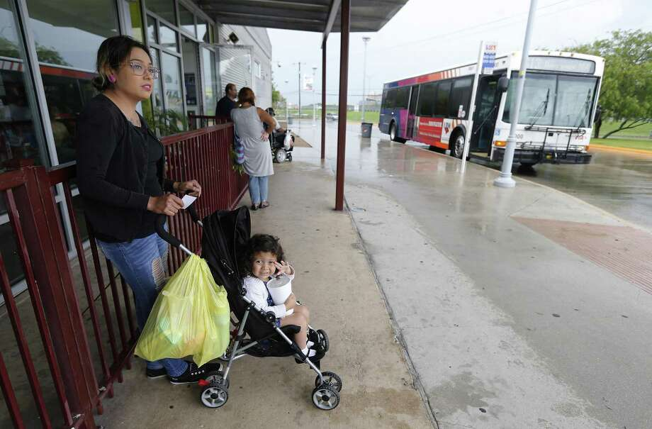 Pamela Lara waits for the bus with her daughter Zoelli at VIA's Kel-Lac Transit Center on June 3, 2016. With the passage of the 2018 budget, San Antonio begins the process of allocating $10 million per year to VIA to increase bus service frequency and expand route capacity — a boon to city residents. Photo: Kin Man Hui /San Antonio Express-News / ©2016 San Antonio Express-News