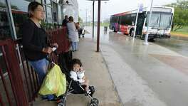 Pamela Lara waits for the bus with her daughter Zoelli at VIA's Kel-Lac Transit Center on June 3, 2016. With the passage of the 2018 budget, San Antonio begins the process of allocating $10 million per year to VIA to increase bus service frequency and expand route capacity — a boon to city residents.