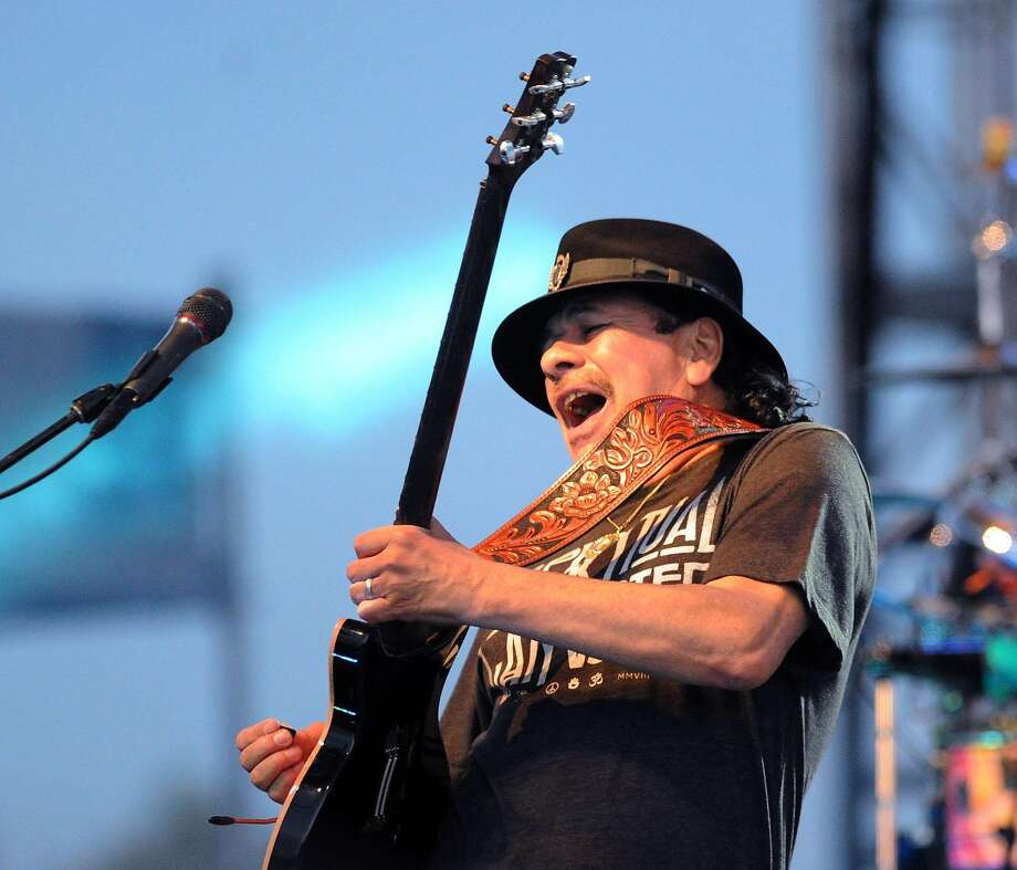 Carlos Santana performs during the Greenwich Town Party at Roger Sherman Baldwin Park, Greenwich, Conn., Saturday, May 24, 2014. Photo: Bob Luckey