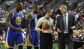 PORTLAND, OR - MAY 9: Draymond Green, Andre Iguodala #9 and head coach Steve Kerr of the Golden State Warriors have some words with referee Scott Foster #48 during the first quarter of Game Four of the Western Conference Semifinals against the Portland Trail Blazers during the 2016 NBA Playoffs at the Moda Center on May 9, 2016 in Portland, Oregon. NOTE TO USER: User expressly acknowledges and agrees that by downloading and/or using this photograph, user is consenting to the terms and conditions of the Getty Images License Agreement.  (Photo by Steve Dykes/Getty Images)