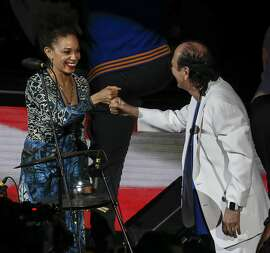 Carlos and Cindy Blackman Santana bump fists after performing the National Anthem before Game 2 of the NBA Finals between the Golden State Warriors and the Cleveland Cavaliers at Oracle Arena on Sunday, June 5, 2016 in Oakland, Calif.