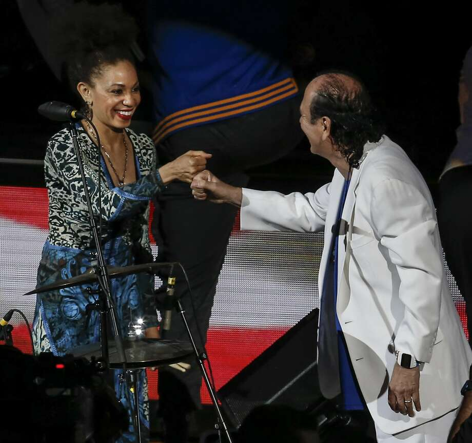 Carlos and Cindy Blackman Santana bump fists after performing the National Anthem before Game 2 of the NBA Finals between the Golden State Warriors and the Cleveland Cavaliers at Oracle Arena on Sunday, June 5, 2016 in Oakland, Calif. Photo: Michael Macor, The Chronicle