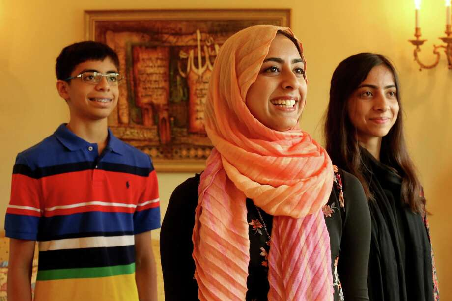 From left, siblings Hamza, 13; Huda, 18; and Zuha Khan, 15, are among the young Muslims across the Houston area who plan to fast from sunrise to sunset each day during Ramadan. Photo: Gary Coronado, Staff / © 2015 Houston Chronicle