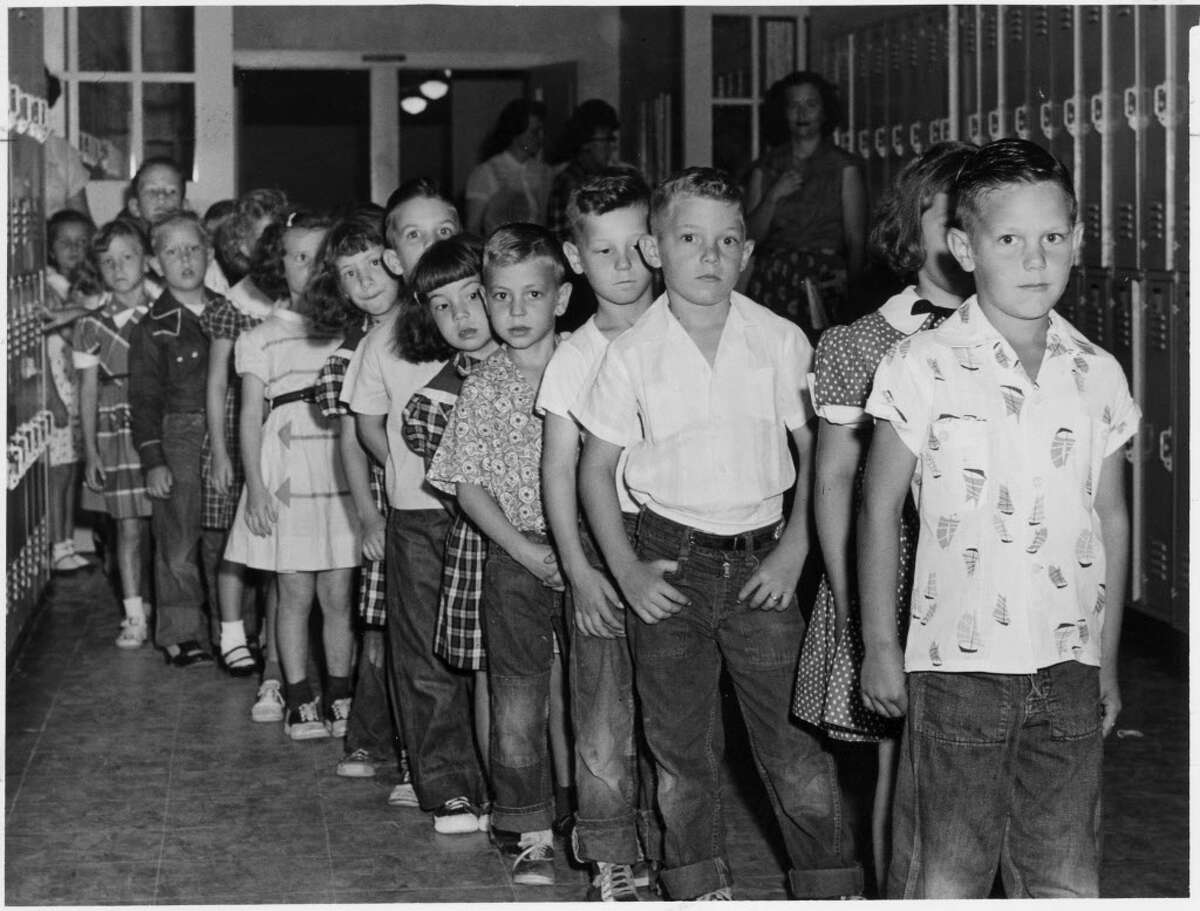Schoolchildren await Salk vaccine shots at Houston's Hohl Elementary in 1955. Harris County's polio crisis was unmatched in Texas.