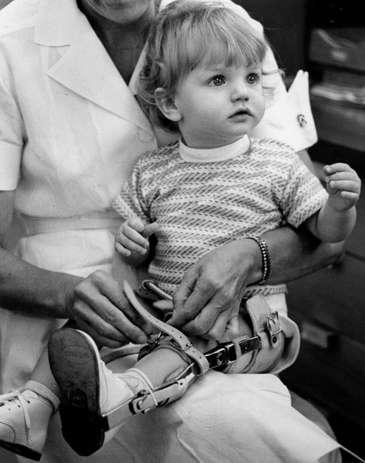 Sabrina Sustaita, who was 10 months old when photographed in 1962, was among the polio survivors who required leg braces.