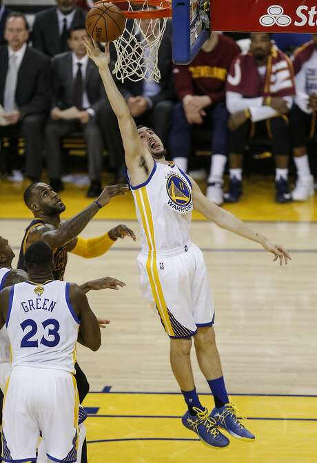 Golden State Warriors' Klay Thompson reaches for a rebound over Cleveland Cavaliers' LeBron James in the second quarter  during Game 2 of the NBA Finals at Oracle Arena on Sunday, June 5, 2016 in Oakland, Calif. Photo: Michael Macor, The Chronicle