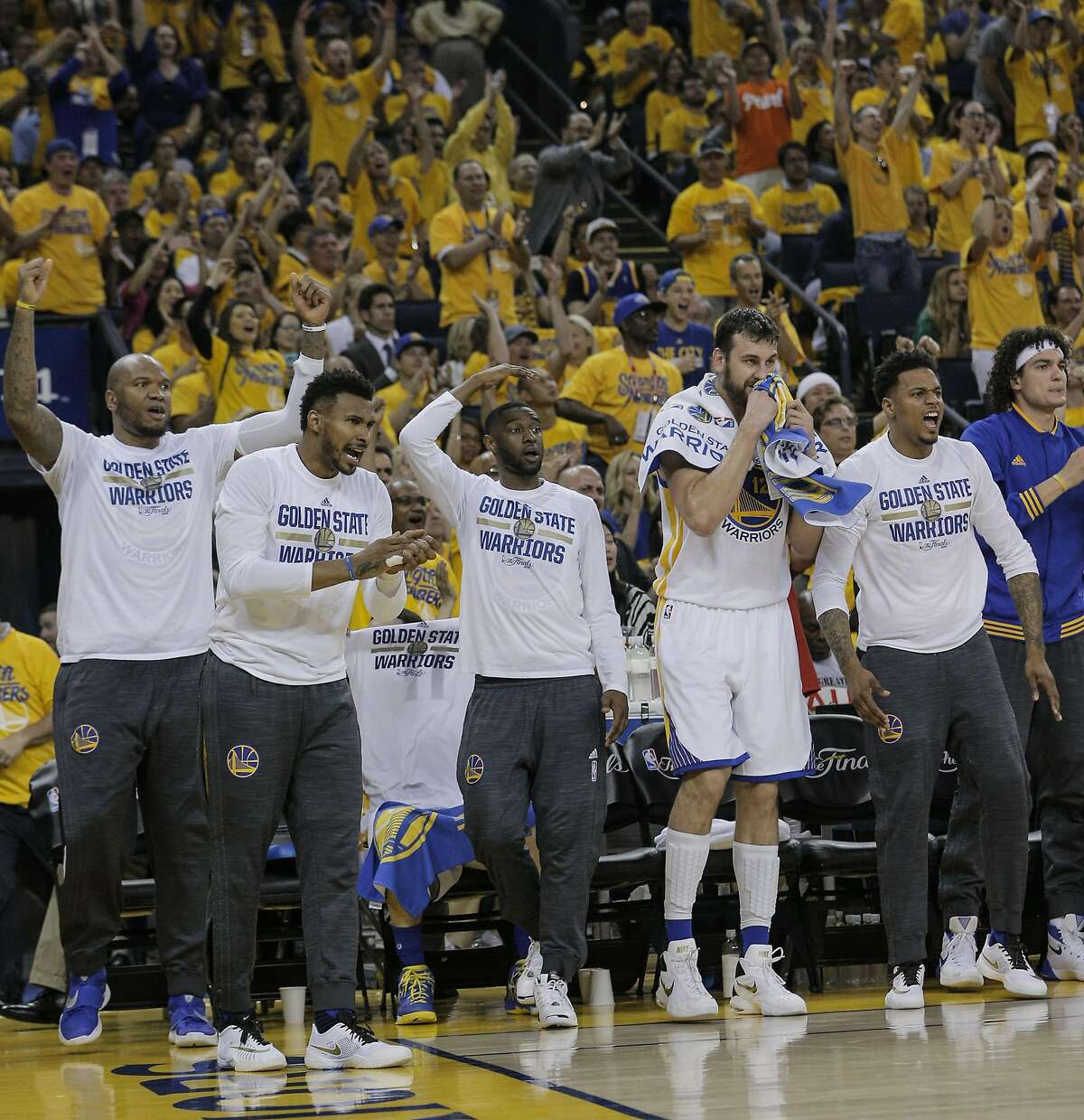 The Golden State Warriors' bench reacts in the first quarter during Game 2 of the NBA Finals at Oracle Arena on Sunday, June 5, 2016 in Oakland, Calif.