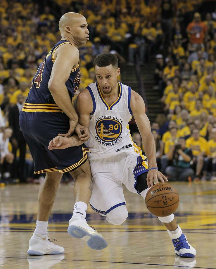 e8dd241b265 Stephen Curry gets past Cleveland Cavaliers  Richard Jefferson in the first  quarter during Game 2