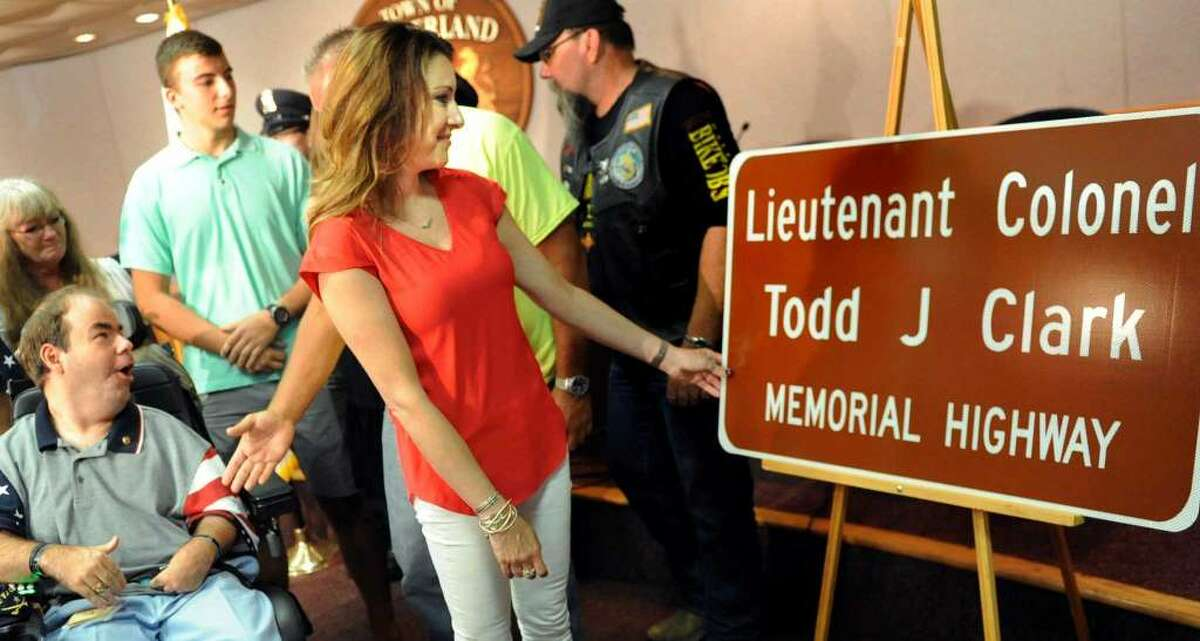 Times Union Archive Shelley Clark, wife of Army Lt. Col. Todd Clark, touches the sign that renames a portion of Route 146 in Guilderland in commemoration of her husband who was killed in the Afghanistan war.