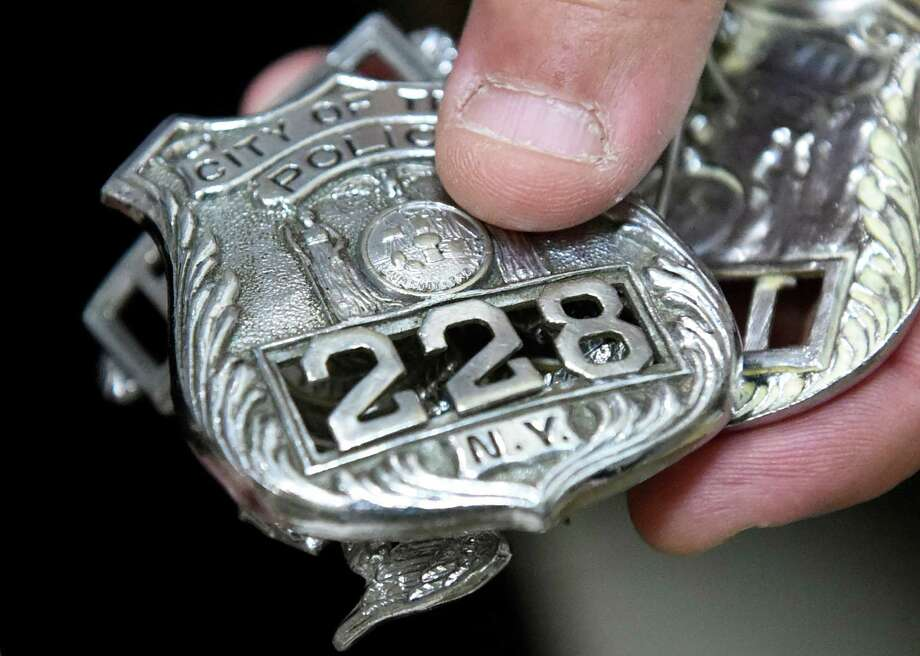 Troy Police badges on Thursday, June 2, 2016, at Troy Police Headquarters in Troy, N.Y. They're refurbished badges from NYP. The department plans to get its own badges cast. (Cindy Schultz / Times Union) Photo: Cindy Schultz / Albany Times Union