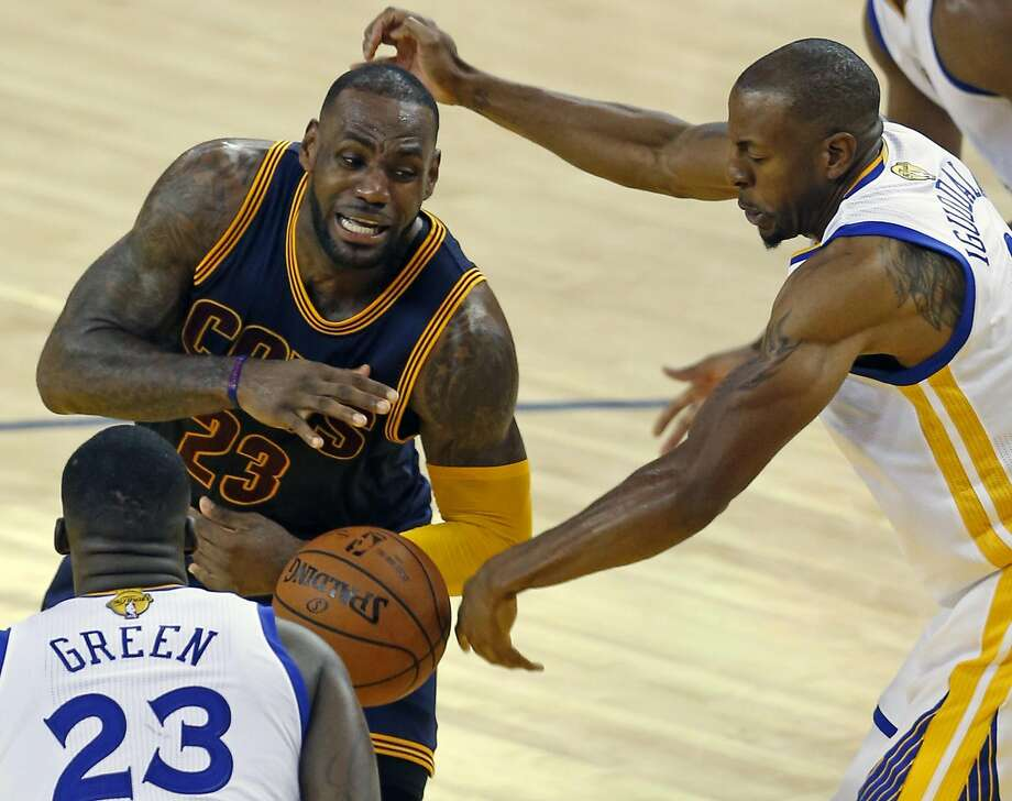 1a75c9a800f Andre Iguodala (right) and Draymond Green gang up on Cleveland s LeBron  James