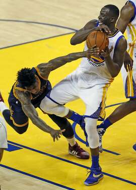Golden State Warriors' Draymond Green steals the ball from Cleveland Cavaliers' Iman Shumpert in 3rd quarter of Warriors' 110-77 win in Game 2 of NBA Finals at Oracle Arena in Oakland, Calif., on Sunday, June 5, 2016.