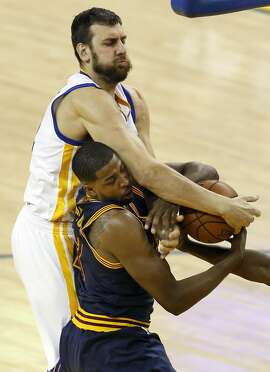 Golden State Warriors' Andrew Bogut battles Cleveland Cavaliers' Tristan Thompson for a rebound in 4th quarter of Warriors' 110-77 win in Game 2 of NBA Finals at Oracle Arena in Oakland, Calif., on Sunday, June 5, 2016.