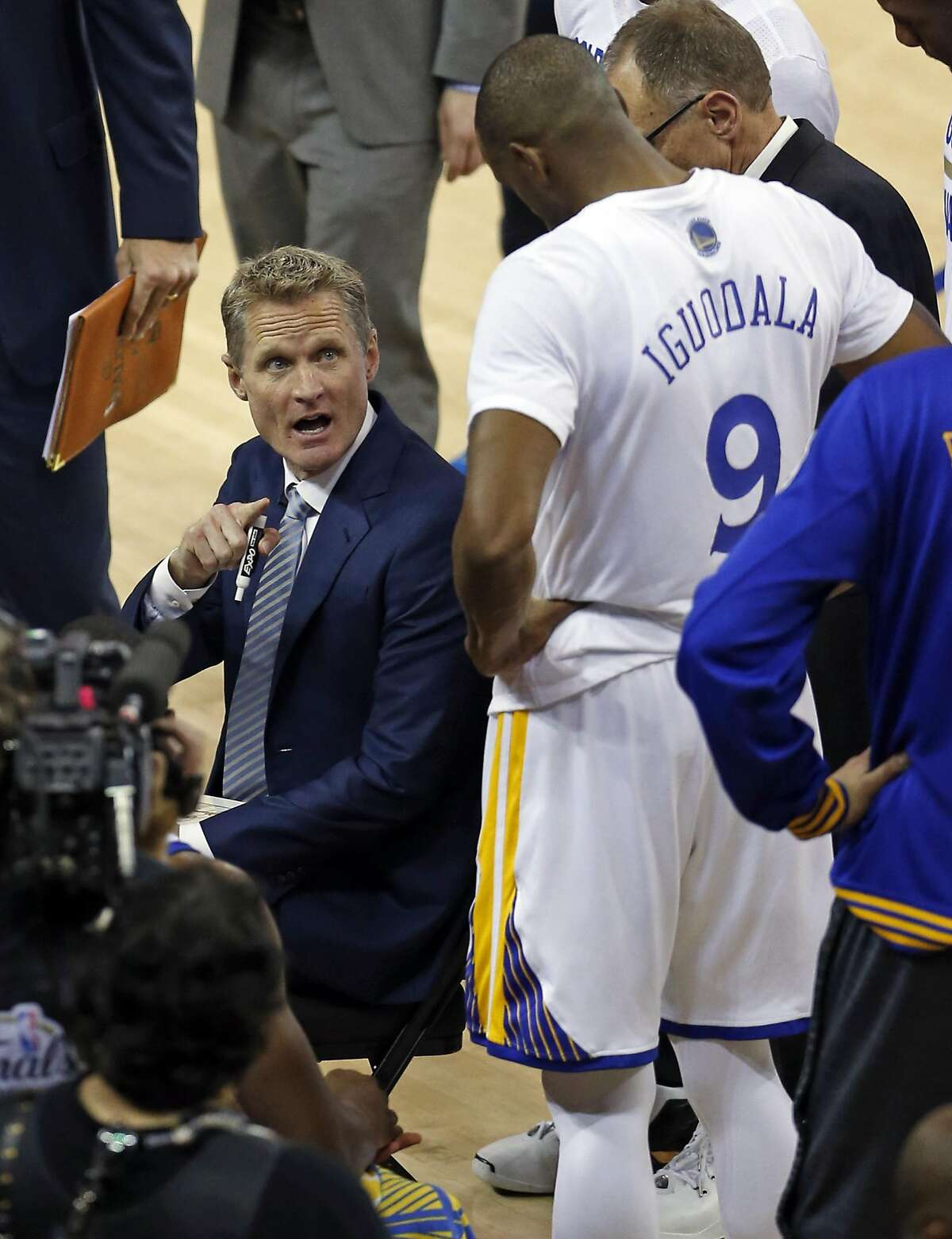 Golden State Warriors' head coach Steve Kerr points to Andre Iguodala during a time out in 3rd quarter of Warriors' 110-77 win over Cleveland Cavaliers in Game 2 of NBA Finals at Oracle Arena in Oakland, Calif., on Sunday, June 5, 2016.
