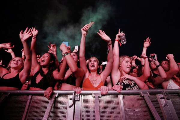 Guilia Wolff, center, cheers as The Chainsmokers perform at Free Press Summer Fest, at NRG, Sunday, June 5, 2016, in Houston.