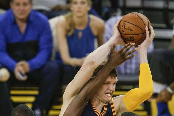 Golden State Warriors' Harrison Barnes guards Cleveland Cavaliers' Timofey Mozgov in the fourth quarter during Game 2 of the NBA Finals at Oracle Arena on Sunday, June 5, 2016 in Oakland, Calif.