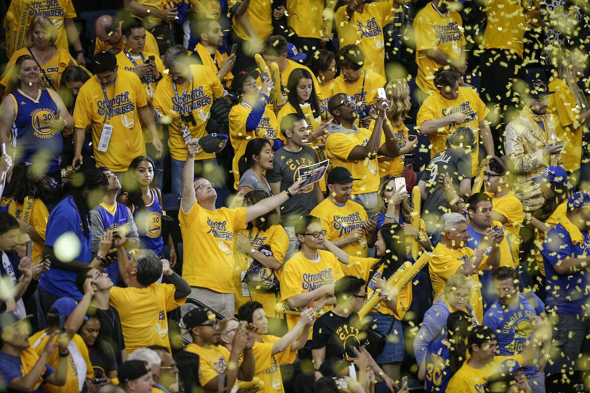 Warriors' fans celebrate the Warriors' 110 to 77 win over the Cleveland Cavaliers during Game 2 of the NBA Finals at Oracle Arena on Sunday, June 5, 2016 in Oakland, Calif.