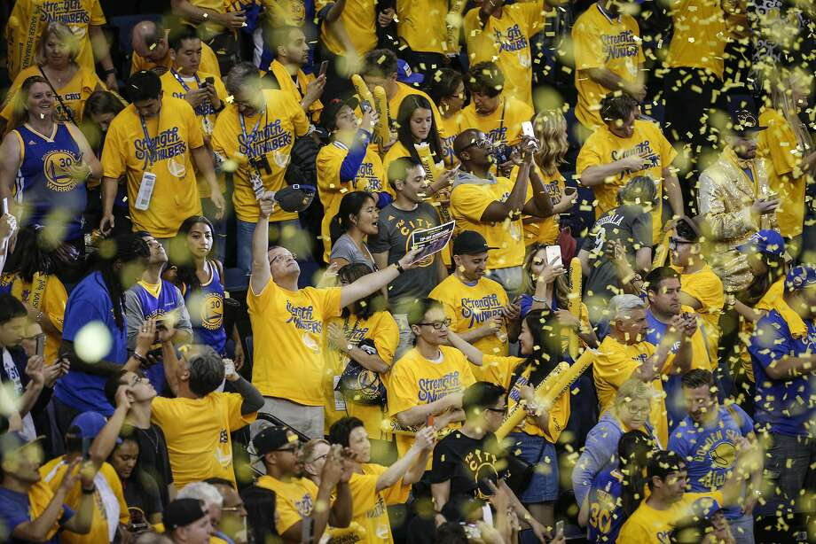 When Warriors fans celebrate, as they did in their Game 2 win over Cleveland, that can mean big sales for Fanatics. Photo: Carlos Avila Gonzalez, The Chronicle