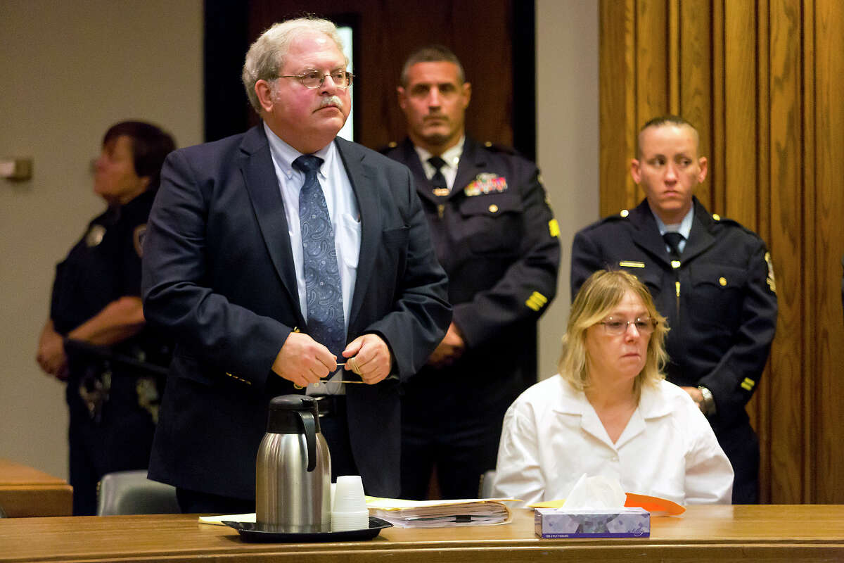 Joyce Mitchell, a former prison employee who provided the tools that two murderers used to cut their way out of a maximum-security facility in northern New York, accompanied by her attorney Steven Johnston, listens during a restitution hearing at the Clinton County Government Center, Friday, Nov. 6, 2015, in Plattsburgh, N.Y. Mitchell's will pay $79,841, plus a 10 percent surcharge, for the damage Richard Matt and David Sweat caused by using hacksaw blades and other tools she provided to break out of Clinton Correctional Facility in June, a prosecutor said. (Gabe Dickens/Press-Republican via AP)