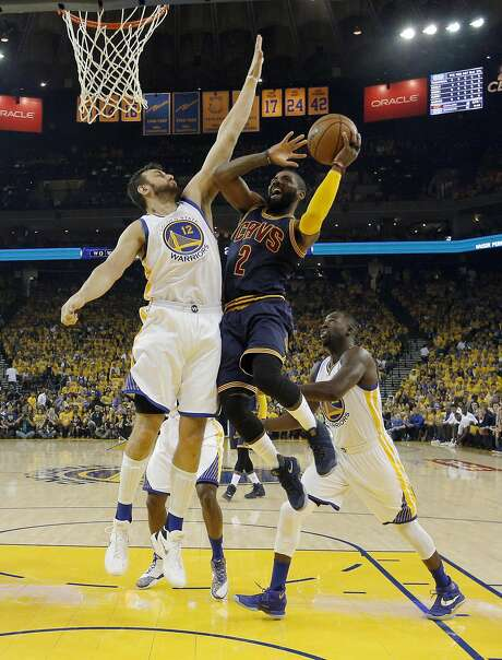 Andrew Bogut (left) defends against a shot by Kyrie Irving in the second half of the Warriors' rout of the Cleveland Cavaliers in Game 2 of the NBA Finals on Sunday. Photo: Carlos Avila Gonzalez, The Chronicle