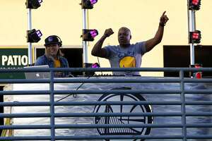Rapper Too Short (right) performs for a crowd after the Warriors won Game 2 of the NBA Finals against the Cleveland Cavaliers at Oracle Arena in Oakland, California, on Sunday, June 5, 2016.
