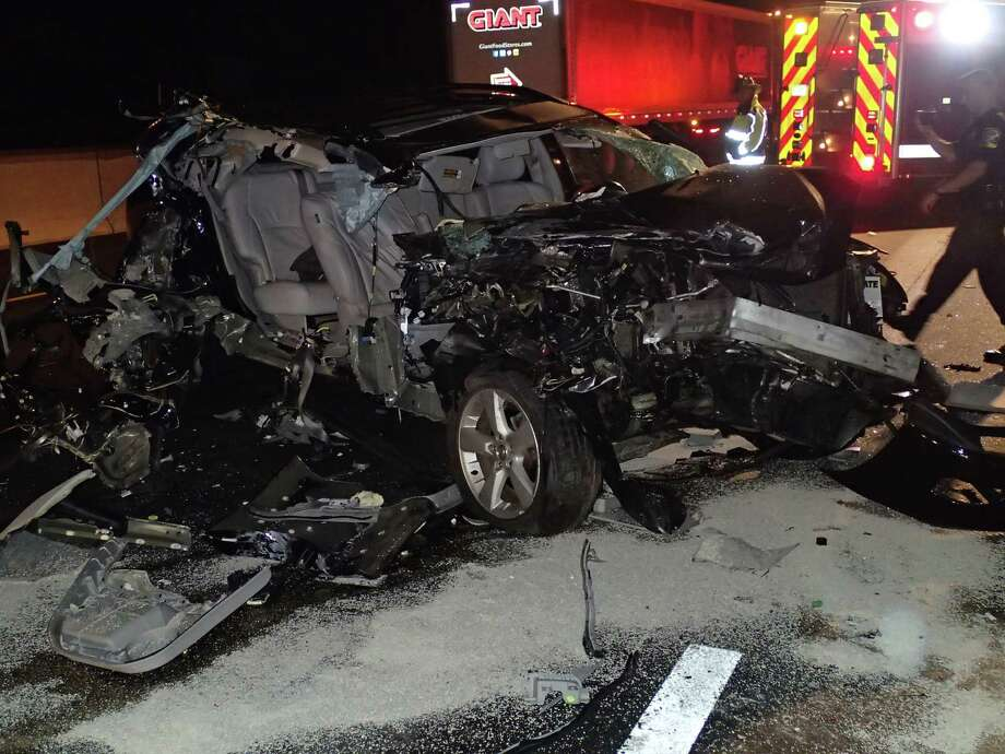 An SUV was heavily damaged in a crash early Monday on I-95 in Westport Photo: Provided Photo / Westport Fire Department