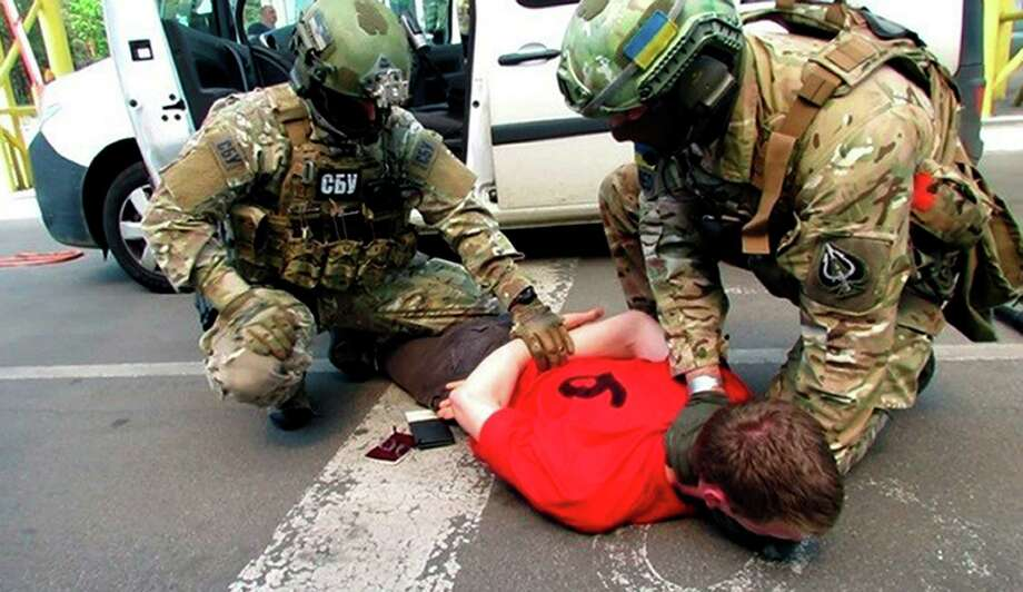 In this image, provided by the Ukrainian Intelligence Agency SBU on Monday, June 6, 2016, SBU agents detain a suspect at the Yahodyn border crossing on the Ukrainian-Polish border, Ukraine. Ukraine's intelligence agency SBU said on Monday it has thwarted a plot to attack soccer's European Championships in France by arresting a Frenchman who wanted to cross from Ukraine into the European Union armed to the teeth. (Ukraine's Intelligence Agency SBU Press Service photo via AP) Photo: AP / Ukraine's Intelligence Agency SBU Press Service