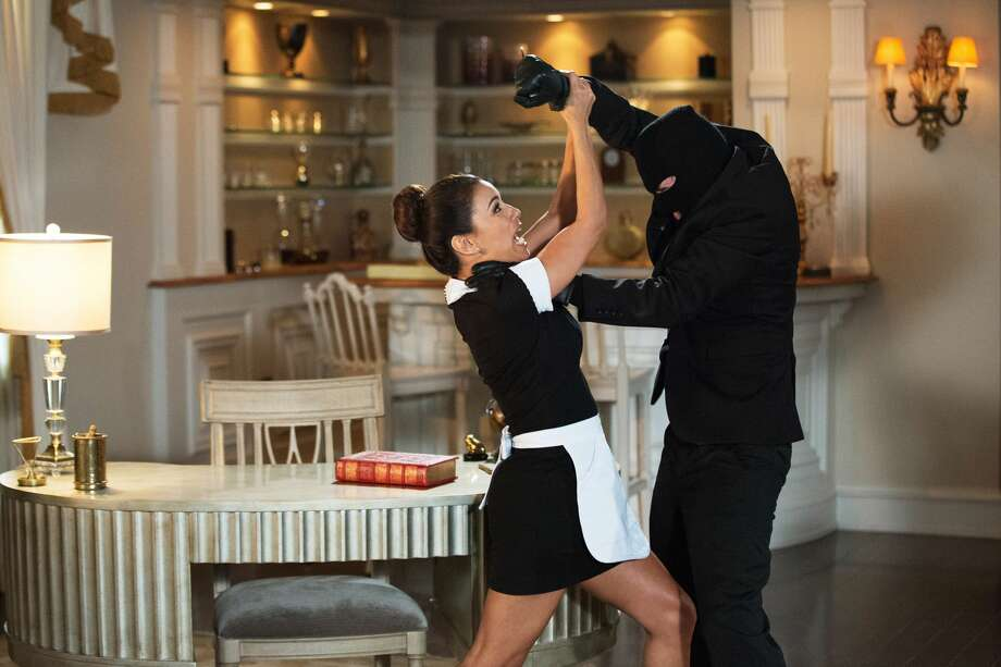Eva Longoria gets chased by a killer in a mask in the opening scene of Season 4 of 'Devious Maids.'  Photo: Lifetime