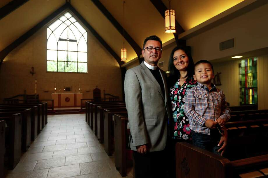 The Rev. Uriel Lopez, shown with wife Lucia and son Carlos at St. Christopher's Episcopal Church, served in the Catholic church before becoming an Episcopalian rector. Photo: Gary Coronado, Staff / © 2015 Houston Chronicle