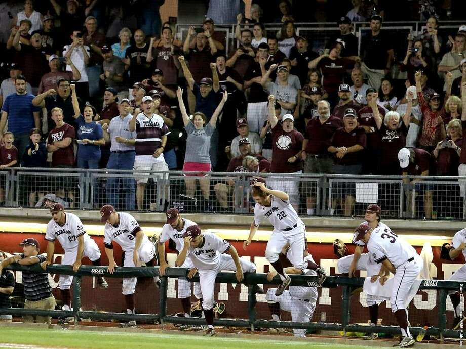 Texas A&M players celebrate after their victory over Minnesota late Sunday, pushing them into the Super Regionals at home against TCU. (A&M SID courtesy photo)