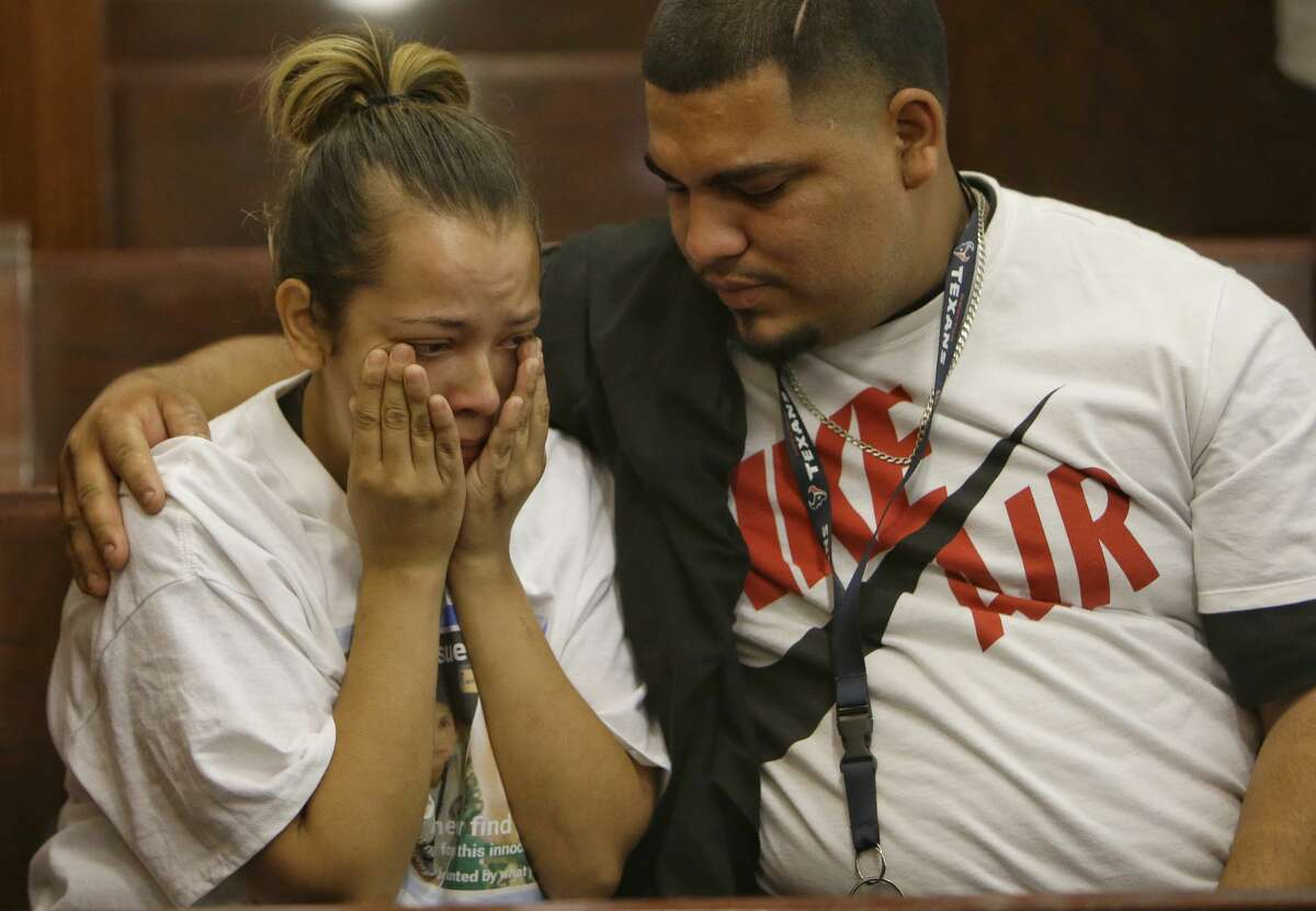 Isidro Barrera, right, comforts his wife, Guadalupe Flores, the sister of Josue Flores, at the Criminal Courthouse, 1201 Franklin, Monday, June 6, 2016 after the court appearance of Andre Timothy Jackson, who is accused in the stabbing death of 11-year-old Josue Flores. ( Melissa Phillip/ Houston Chronicle)