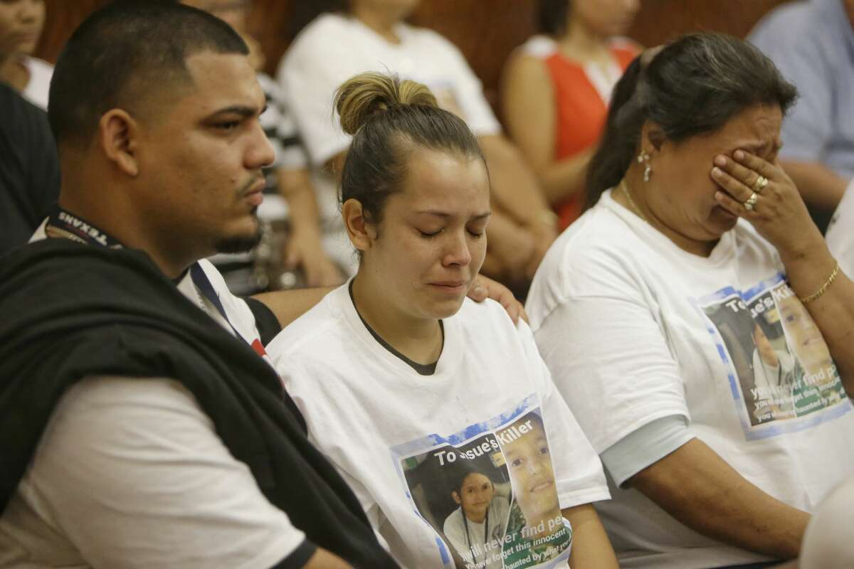 Isidro Barrera, left wife, Guadalupe Flores, the sister of Josue Flores, and other supporters are shown in Criminal Courthouse, 1201 Franklin, Monday, June 6, 2016 during the court appearance of Andre Timothy Jackson, who is accused in the stabbing death of 11-year-old Josue Flores. ( Melissa Phillip/ Houston Chronicle)